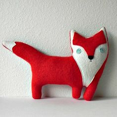 Handmade plush fox pillow   Three Bad Seeds -- such a sweet extra touch to an animal-themed room.