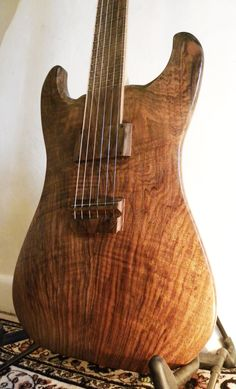 Halflight Guitars Naiad 2... beautiful uniform coloring and like the bridge design