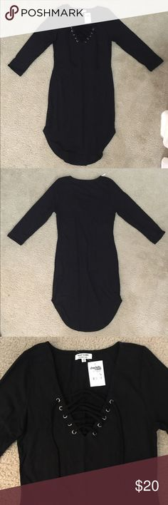 NWT Charlotte Russe Black Lace-up Dress Charlotte Russe mini black dress with lace up front. New with tags! Received as a gift and is not my size. Never been worn and has been stowed away in a drawer. Charlotte Russe Dresses Mini