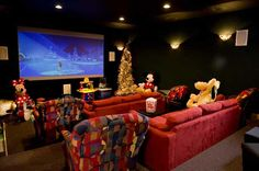 Even the home theater (with a Disney theme naturally) has a little Christmas tree. Log Home Living , Design by your plans and Live The Life