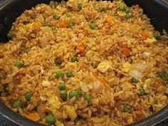 Easy fried rice, better than takeout!  3 cups cooked white rice (day old or leftover rice works best!)  3 tbs sesame oil  1 cup frozen peas and carrots (thawed)  1 small onion, chopped  2 tsp minced garlic  2 eggs, slightly beaten  1/4 cup soy sauce