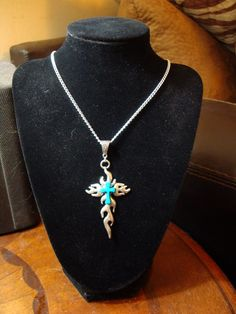 Turquoise and Silver colored Cross. $9.49 Click pic for info.