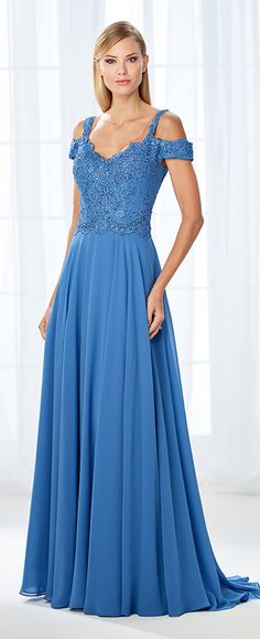 Simultaneously trendy and classic, this cold shoulder chiffon A-line gown features a scalloped lace sweetheart bodice adorned with sparkling heat set stones, and a full chiffon skirt with a sweep train. A matching shawl is included.