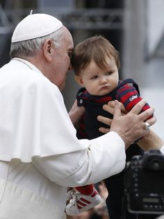 Pope Francis blesses a child in St Peter's Square at the Vatican April 3 (CNS photo/Paul Haring). Popes and babies: a classic winning adorableness combo.