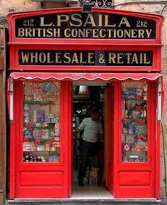 Psaila British Confectionery store front in Valletta, Malta ✯ ωнιмѕу ѕαη∂у Vintage Store, La Petite Boutique, Malta Island, Grades, Shop Fronts, Shop Around, Beautiful Islands, Around The Worlds, Exterior