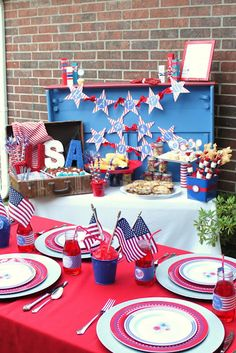 I love the use of an old suitcase as table decoration! Memorial Day or 4th of July Party