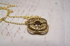Life Preserver Necklace. Lifeguard. Nautical.Ocean. Pool.Swimming. antique brass version