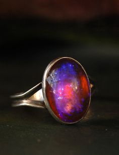1920s Dragon's Breath Opal Ring.  Dragon's Breath is just glass, but it's  about as incredible as any naturally occurring stone. Depending on how the light hits it, it looks like amber, ruby, moonstone, or some sort of psychedelic amethyst.
