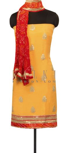 Yellow unstitched suit in pritned butti only on Kalki