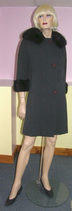 Vintage coat with real fur on collar and cuffs.