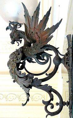 Originally an iron gas lamp in the shape of a dragon. Barcelona.