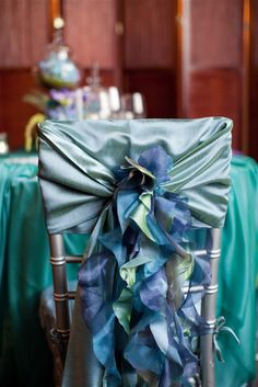 Peacock wedding sweetheart table chair..using just the ribbon for aisle decorations on the end of chairs
