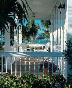 beach house with lovely porch. now all I need is a book and a cool tall glass of something fresh...