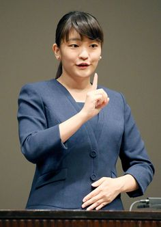 Japan's Princess Mako, a granddaughter of Emperor Akihito, delivering a speech with sign language at a sign language speech contest among high school students in Tokyo in August 2016. The 25-year-old Princess will soon become engaged to a man who also went to Tokyo's International Christian University, the Imperial Household Agency said on May 16, 2017.