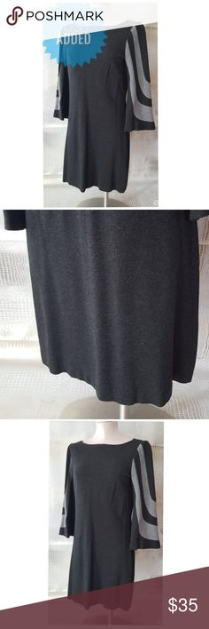 Trina Turk mini dress or long top This  Trina Turk mini dress or wear it as a long top as I did with jeans is a great addition to any wardrobe it is super soft has these fabulous Bell sleeves with a very elongating gray Line Design on the arms wear it casually or wear it to the office throw on sexy heel and wear it for date night   Pre owned condition *******All items are in pre owned condition, Nothing, unless noted , is brand new **** please ask questionsFor sale in my posh closet  LINK IN…