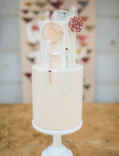 Two tier cake with dreamcatcher adornments