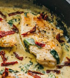 This chicken skillet dinner has garlic, sun-dried tomatoes, and spinach in a creamy buttery sauce.