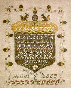 Rosewood Manor Acorns All Around - Cross Stitch Pattern. Model stitched over 2 threads on Raw Cashel using DMC floss. Stitch count: 140h x 110w.