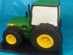 Grooms John Deere Cake Strawberry cake with Strawberry filling and Rice Crispies for tires covered in modeling chocolate. Used oreo cookies. Strawberry Filling, Strawberry Cakes, Tractor Birthday Cakes, Cake Models, Modeling Chocolate, Oreo Cookies, Grooms, 2nd Birthday, Color Mixing