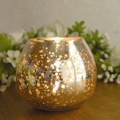 We love the unique shape and eye-catching gold color of this votive.