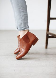Camel booties and gray pants