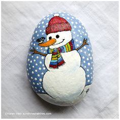 Snowman with chickadee, painted on a beach rock.