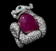 Chinese Influences – High Jewelry Ring White gold, one 34.58 -carat cabochon-cut ruby, emerald eyes, one natural pearl, onyx, brilliants.
