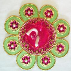Decorate your home in this diwali with combination of Green & Pink colour handmade 13 piece Wooden Rangoli at affordable price.