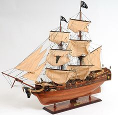 "CaptJimsCargo - Caribbean Pirate Ship Handcrafted Wooden Model 37"" Sailboat, (http://www.captjimscargo.com/model-pirate-ships/caribbean-pirate-ship-handcrafted-wooden-model-37-sailboat/) Besides the hundreds of details that tall ships have, this model has 5 little pirate men and women made of metal."