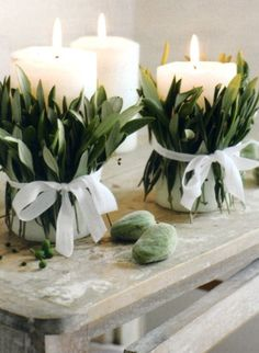 leafy candles  Easy DIY. Wrap inexpensive candles with Bay Leaves Rosemary or and a ribbon.   Monitor flame! #mombodysoul