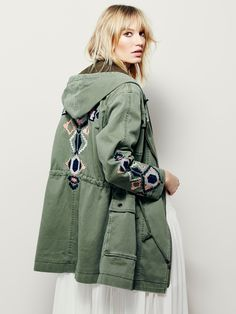 Embroidered Twill Parka | Distressed cargo jacket with tribal-inspired embroidery on the sleeves and back. Drawstring ties at front of neckline and waist. Zipper opening in front. Four front snap pockets. Hooded. Lined.