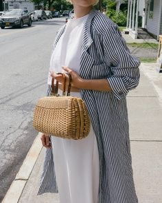 80s striped linen duster (available at vauxshop.com) / wicker basket purse with lucite handles $68 DM to purchase