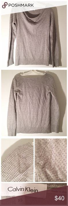Calvin Klein Sweater This sweater by Calvin Klein has been worn only once. It has beautiful jeweled detailing on the shoulders. The sweater is a light gray and the shoulder jewels are silver. Gorgeous!! Offers will be kindly considered!! 🛍💖 Calvin Klein Sweaters