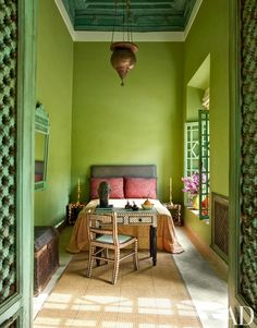 A Persian light hangs in the Green Bedroom of a Marrakech riad by Sardar Design Studio; the bedspread is Gujarati mirrorwork embroidery, the chest is Moroccan, and the desk and chair are embellished with bone inlay. Bedroom Green, Bedroom Decor, Moroccan Bedroom, Bedroom Retreat, Bedroom Modern, Ethnic Bedroom, Narrow Bedroom, Bedroom Ideas, Master Bedroom