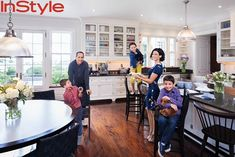 Jerry and Jessica Seinfeld's Hamptons House InStyle  This is a mid tone floor, but the room is anchored with black coutnertops