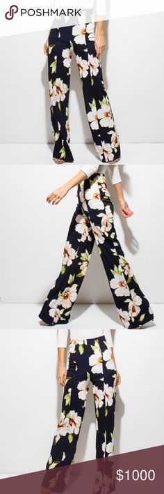 """~GOLDEN BUTTON HIGH WAISTED BOHO WIDE LEG PANTS~ ~ARRIVED!~  ~Dress up any outfit with these floral print wide leg pants, with the perfect tough of glam with golden buttons~  ~These high waist pants are made of exclusive rose floral print fabric, giving you a truly unique look!~  ~96% Polyester~ ~4% Spandex~  ~Our model is 5'9""""  ~Hips are 34"""" ~Waist is 24""""  ~Modeling a size small~  ~Please feel free to ask any questions you may have~  ~Reserving in the comment section below~xoxo Pants Wide…"""