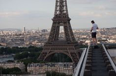 Vitaliy Raskalov gets a view of the Eiffel Tower that few tourists in Paris get.