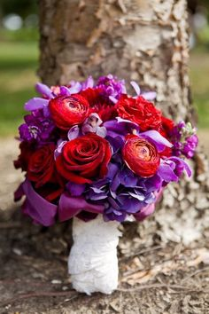 Red roses and ranunculus flowers with purple hydrangeas by Mary Tuttle's Flowers | Photography: Megan Thiele Photography | Wedding Planner: Cosmopolitan Events