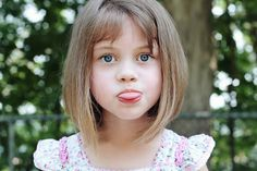 Long Bob with Bangs. This longer version of a classic bob is great because the length gives you the option of little pigtails. The bangs are an awesome choice to keep the haircut from feeling heavy around the face. Short bangs are just adorable on kids and they help up the style factor. Read more at http://www.latest-hairstyles.com/kids/summer.html#rFbqoJjQwMrhX3q0.99