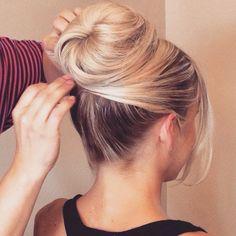 pretty updo with a twist on the standard bun - simple + elegant