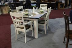 nice white wooded table perfect for a pation--- White is so elegant looking.