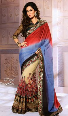 Frame your bold look over this cream, red and royal blue georgette net half n half saree. This charming attire is displaying some fantastic embroidery done with lace, resham and sequins work. #EveningWearSarees
