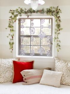 #DIY Snowflake Curtain: Framed with greenery. This is so easy to make! http://www.hgtv.com/handmade/how-to-make-a-snowflake-curtain/index.html?soc=pinterest