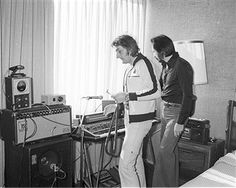 Bass player John Entwistle of the rock and roll band 'The Who' rehearses in a hotel room with another man in August 1979 in Los Angeles, California.