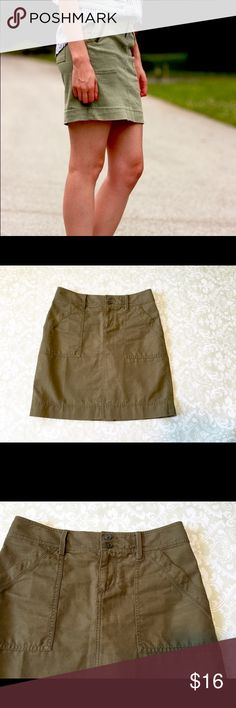 Loft olive green cargo skirt Loft olive green cargo skirt. Two front and back pockets. Belt loops two front buttons with zipper. 18 inches long. Size 0. First pic not actual skirt. LOFT Skirts