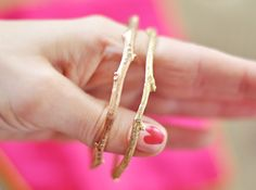 gold bangles cast from actual tree branches, and encrusted with tiny diamonds to resemble the knots...in love. i will take 2 in white gold