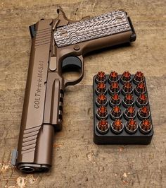 Colt firearms M45A1 with RIP rounds lined up.                                                                                                                                                      More