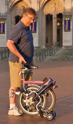 Tim walking the folded Brompton in Red Square
