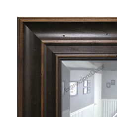 This wall mirror adds just the right distinction to any wall. Hang in the dining room, hallway or any room where a mirror would add depth to the space. Finished in an warm distressed walnut stain, producing a wall mirror with outstanding appeal. A wonderful finishing touch to any room. All framed mirrors have 2 wire hangers attached to the back (or 2 saw tooth hangers depending on size ) and are ready to hang. Can be hung vertically or horizontally.