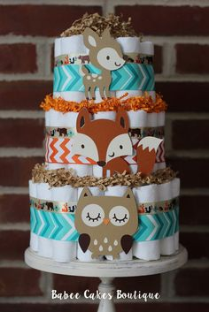 3 Tier Woodland Animal Diaper Cake, Boys Woodland Baby Shower, Fox, Owl, Deer, Centerpiece, Decor, Teal Orange Chevron, Gender Neutral Cake by BabeeCakesBoutique on Etsy https://www.etsy.com/listing/238649635/3-tier-woodland-animal-diaper-cake-boys